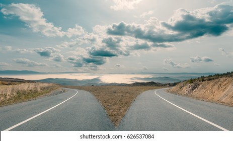 In front of two apparently same roads before the decision which is the right choice. Success concept.