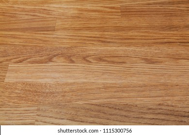 Front upper view down on flat wooden board with wood texture lit with artificial light