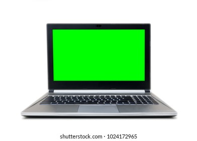 front view af isolated grey and black laptop with green screen