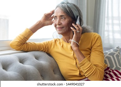 Front view of African American Woman talking on the phone. Authentic Senior Retired Life Concept