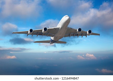 Front view of aircraft in flight. The passenger plane climb above the clouds.