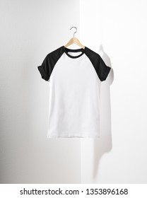 Front view of American Hipsters retro classic tshirt clothes. Blank template of vintage t-shirt hanging on a hanger on white background.