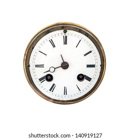 Front view of an ancient clock dial with roman signs isolated on white