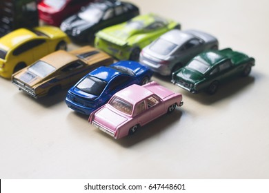 front view assorted metal colorful toy car collection on light background selective focus natural light
