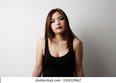 Front view of attractive Chinese woman posing on the white background. Isolated.