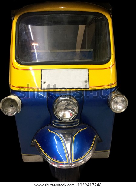 """front view of an auto rickshaw called a """"tuk tuk"""" used commonly as a form of transport in South East Asia"""