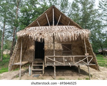 Front view of beach wooden hut constructed with renewable natural materials using bamboos and palms