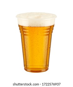 front view beer with foam in glass and white background