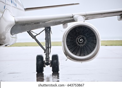 front view of a big jet plane turbine reactor in an airport