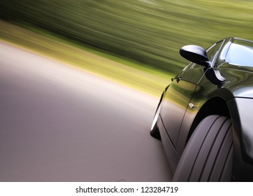 Front view of black car in turn