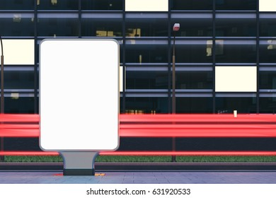 Front view of a blank vertical billboard standing in the night street near a building with glowing windows in the background. 3d rendering, mock up