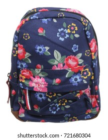 Front view of blue textile female backpack with colored flowers pictured, zippers, straps and handle, isolated on white
