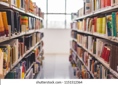 Front view from a book hall in a library. Through this image we can find things about education, study, school, science and mutch more.