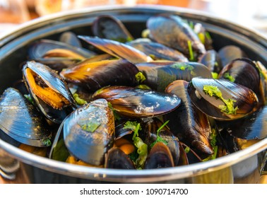Front view of a bowl of mussels with fries. A traditional belgian summer dish. Photographed in Ostend, Belgium.