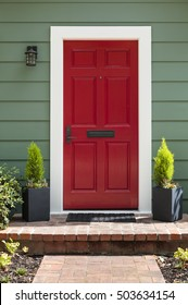 Front view of a bright red front door.