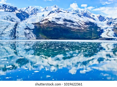 front view of bryn mawr and smith glaciers, snowcapped mountains, and their reflections forming a natural circle in college fjord alaska usa