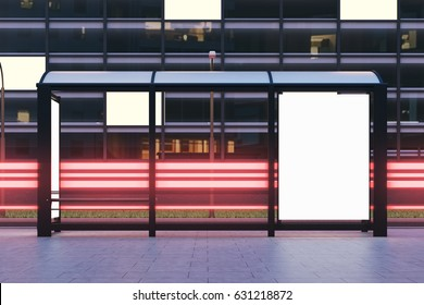 Front view of a bus stop with two blank vertical billboards standing in the night street near a building with glowing windows in the background. 3d rendering, mock up