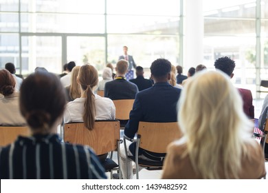 Front view of Caucasian businessman doing speech in conference room