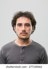 front view of caucasian man with blank expression. real people portrait