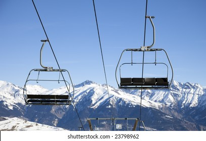 front view of chair lift moving up and down.