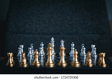 Front view of chess game on chessboard with blur foreground. Business game competitive strategy. Concept of strategic for business.