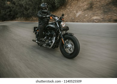 Front view of classic motorbike rider riding an American classic motorcycle