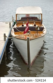 Front view of a classic wooden Chris-Craft lake boat on Lake Winnipesaukee, NH.