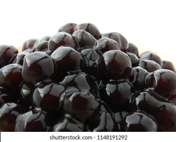 Front view and close up of black tapioca ball (also known as boba in bubble tea) which is ingredients for making pearl milk tea, other Taiwanese drink and shaved ice at dessert shop. Food background.