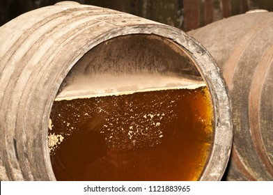 Front view, close up of a wine barrel top,  with glass insert, showing the aging fermentation process of sherry, in a three generation wine cellar, in the southeastern region of Spain