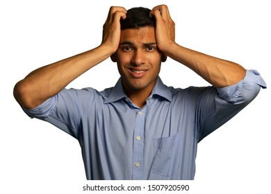 Front view close up of a young mixed race man wearing a blue shirt looking to camera and holding his head in frustration