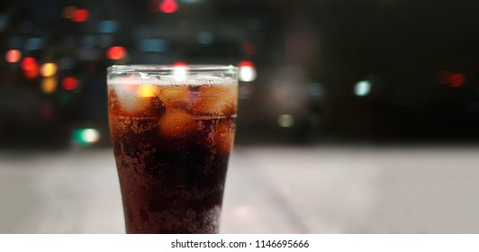 Front view, Cola soda with ice and bubble, cold drink beverage on night background