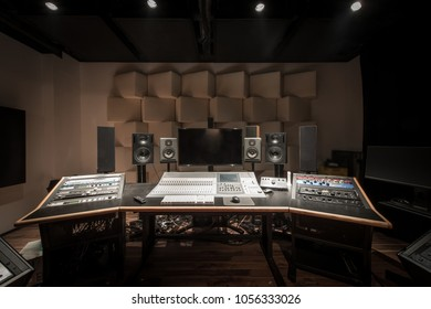 Front view of control desk in music studio room