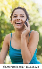 Front view of cute young woman phoning with her smartphone