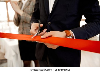 Front view of the cutting the red ribbon on the grand opening of the building