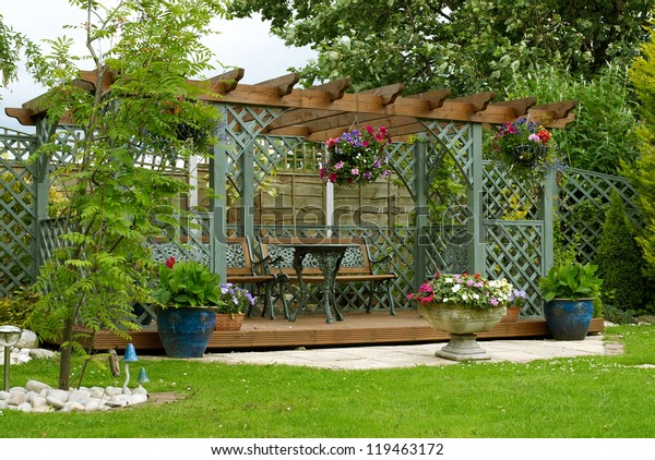 Front View Of A Decorative Pergola In An English Urban Garden