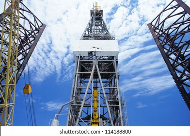 Front View of Derrick of Offshore Oil Drilling Rig and Rig Legs on Sunny Day