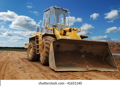 Front view of diesel wheel loader bulldozer with bucket pulled down outdoors