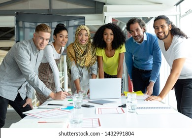 Front view of diverse business people looking at camera while working together at conference room in a modern office - Shutterstock ID 1432991804