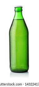 Front view of drink in green bottle with drops isolated on a white