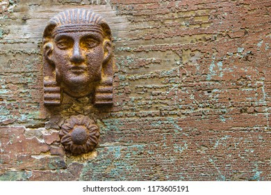 Front view egyptian style sculpture ornate objet at wooden door