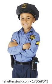 """Front view of an elementary """"policeman"""" smiling at the viewer with his arms folded.  On a white background."""