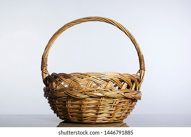 Front view of an empty wicker basket on a white background