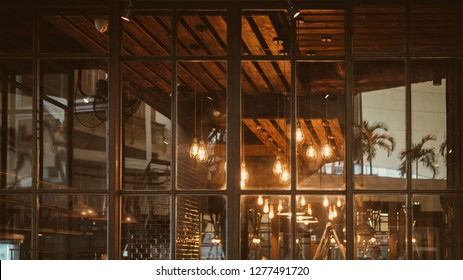 Front view entrance steel glass door of restaurant decorate in vintage style