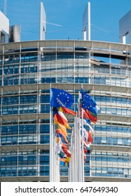 Front view of European Union flag fly half-mast European Parliament building memory of victims terrorist explosion Manchester Arena Ariana Grande concert