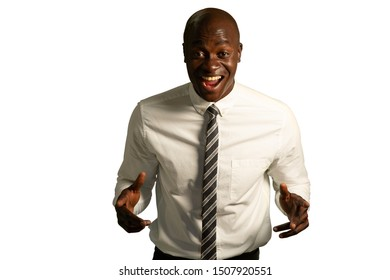 Front view of an excited bald young African American businessman wearing a shirt and tie, looking straight to camera with his hands raised