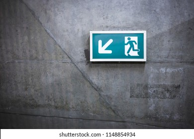 A front view exit sign witch represent warning, urgency, security. It's used in places to informe the peoples.