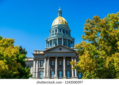 front view facade of Denver , Colorado State Capitol building with blue sky and perfect morning sunshine in the gorgeous mile high city