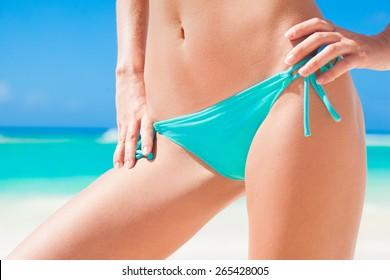 front view of fit young woman in bluebikini. close up