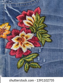 Front view floral embroidered pattern Blue Jeans denim texture