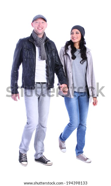 Front view of going young couple (man and woman) . walking girl and guy in jacket and jeans together. Isolated over white background.